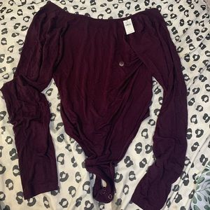 NWT arie body suit!